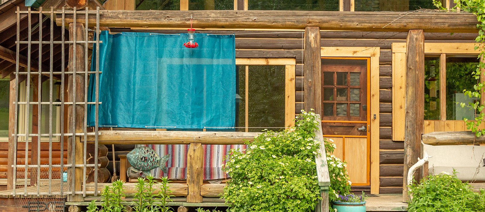 Privacy panel hung horizontally outside a wooden house