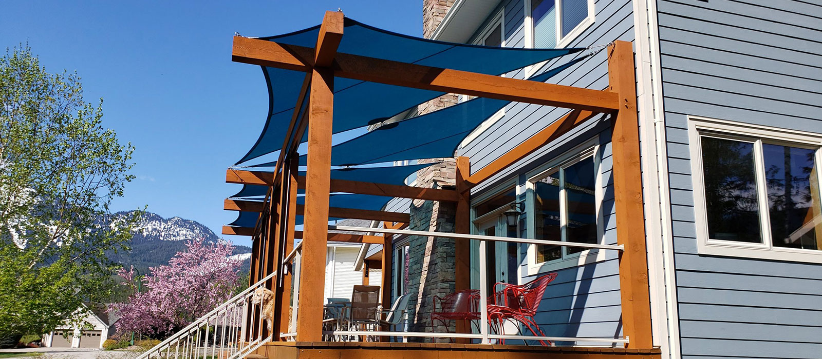 Custom sized shade sails fitted to a shade pergola on a porch